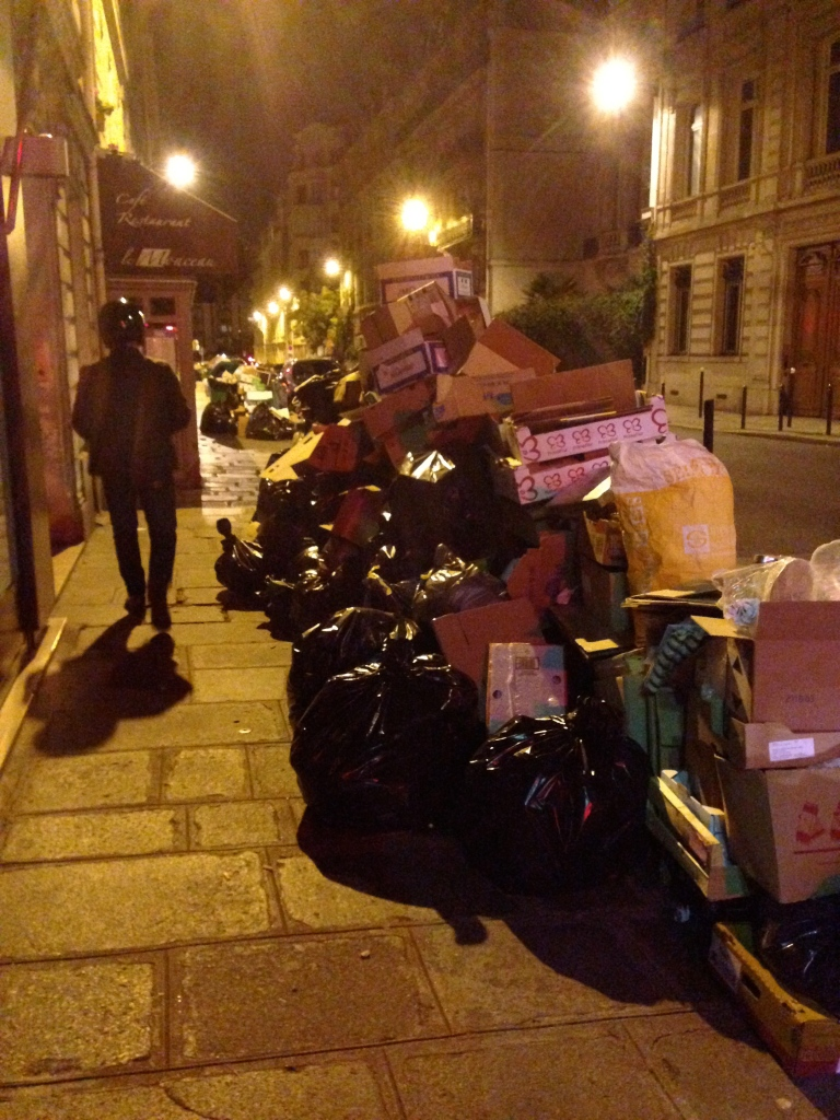 This week, Parisian garbage collectors went on strike, leaving heaps of trash bags along the sidewalk.