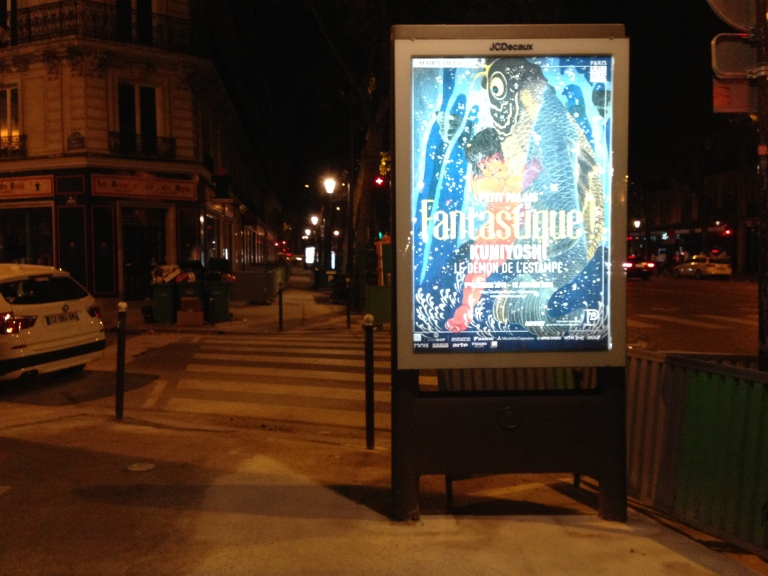A glowing street advertisement on Boulevard Malesherbes around 3 a.m. (no, I did not go for a run at 6 that day).