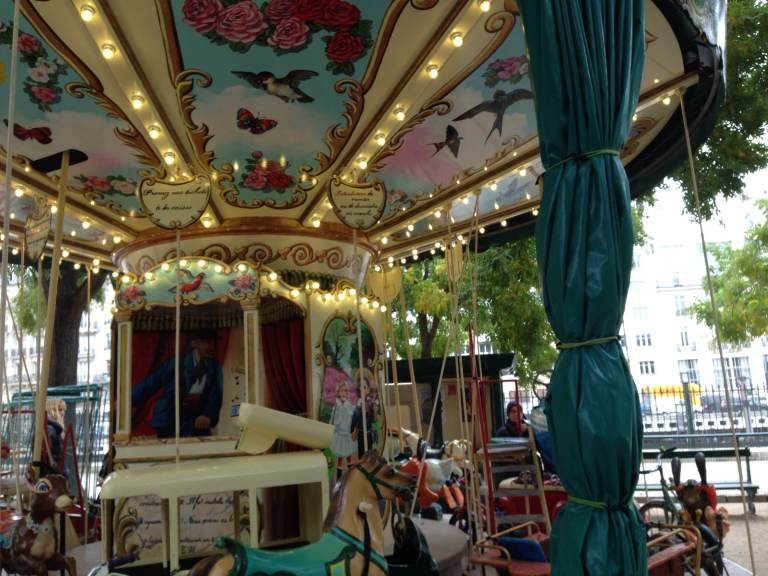 A carousel at a small park in the 17th.