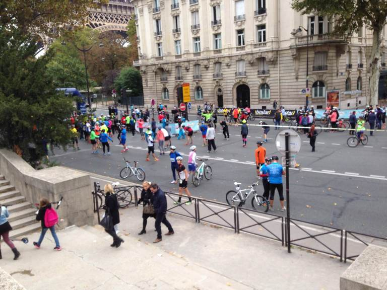 Runners and cyclists mull around near the starting line of a race by the Tour Eiffel on Sunday.