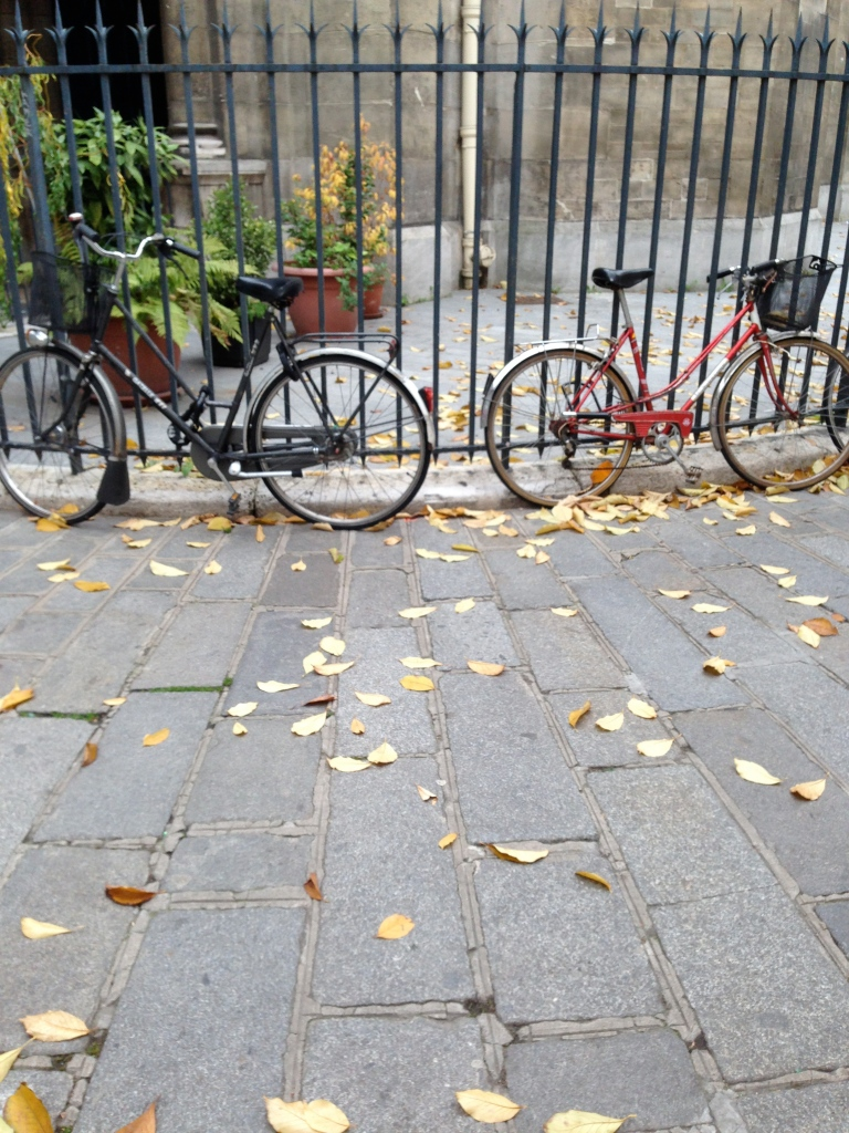 An old church's iron fence proves a popular place to lock bicycles at the edge of Paris's 11th arrondissement.
