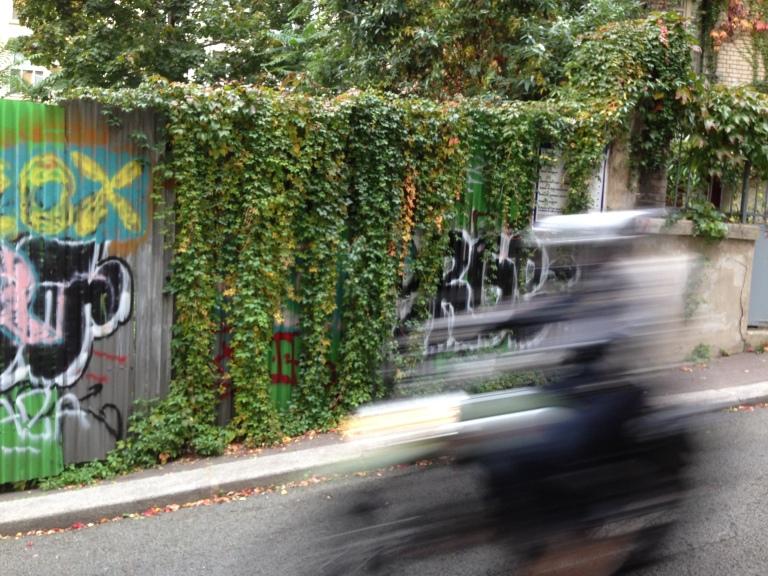 A motorbike speeds down the sloping Rue de Juillet in Paris's Belleville neighborhood.