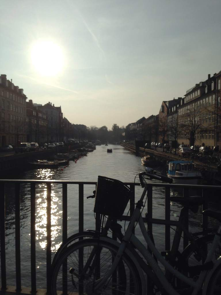 Copenhagen is divided by canals but brought together by bikes (and don't forget the boats).