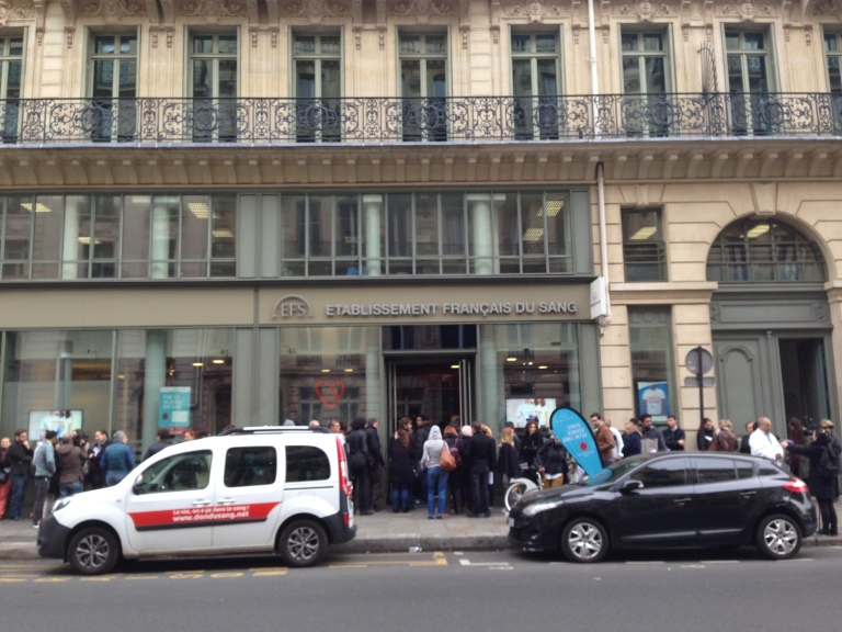 Parisians line up outside the Etablissement Français du Sang waiting to donate their blood on Rue de Châteaudun in the 9th arrondissement.