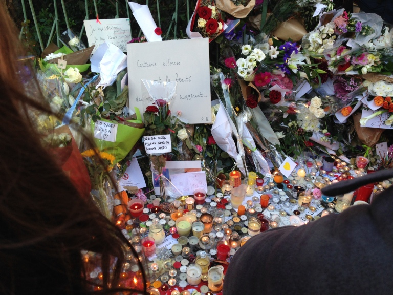 Candles and letters fill the sidewalk on Boulevard Voltaire outside of the Bataclan on Nov. 15, 2015.