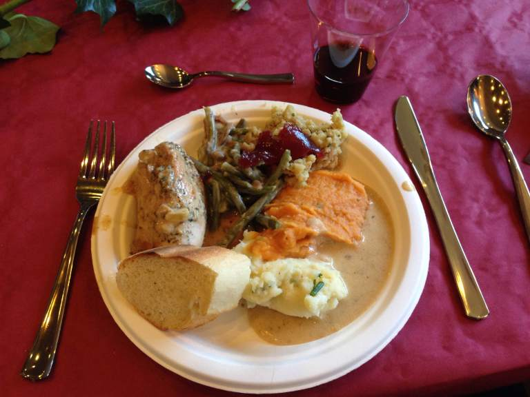 A French Thanksgiving dinner: all of the good stuff, plus wine.