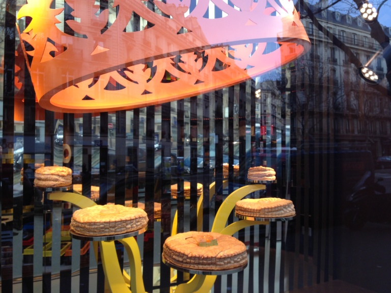 Galettes des Rois in a boulangerie window on Boulevard Malesherbes in Paris's 8th arrondissement. Many bakeries have festive window displays throughout January to celebrate and sell pastries for Three Kings' Day.