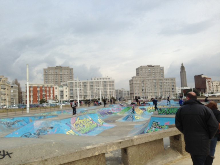 The skate park on Le Havre Beach, where families strolled during a brief window of sunlight.