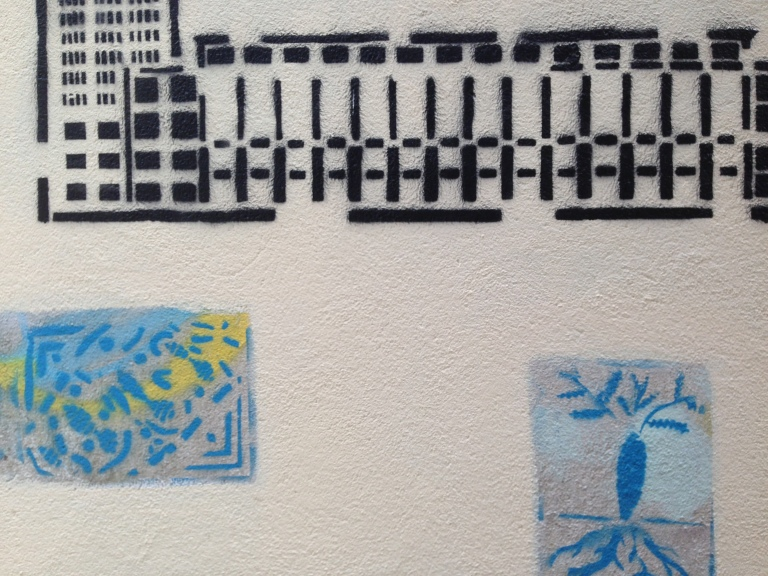 Street art in the old alleyways of Le Havre, including a pattern reminiscent of the city's design.