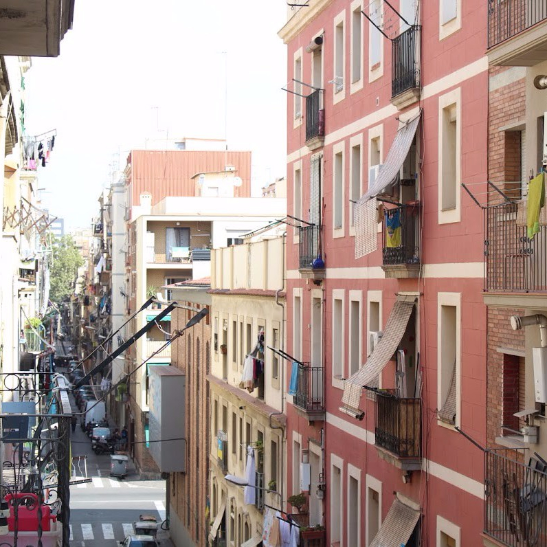 A lively street in Barcelona's Barceloneta neighborhood near the beach.