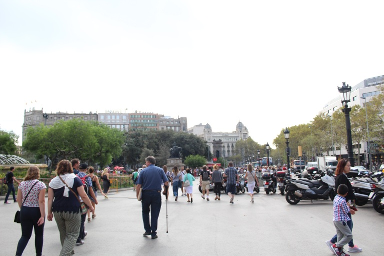 Perhaps the mecca of Barcelona tourism: Plaça de Catalunya, the giant town square where cameras and fanny packs roam free.