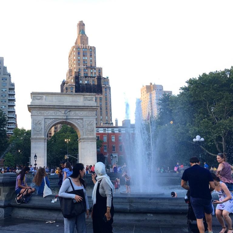 Washington Square Park fountain at dusk.